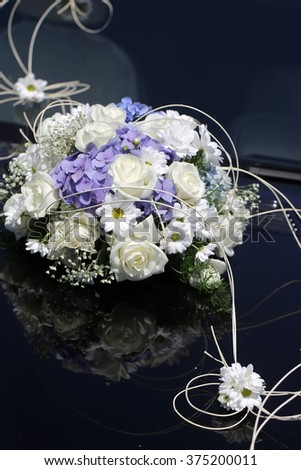 Beautiful tender elegant wedding fresh female bouquet with white roses camomile and lilac flowers floral wonderful decor for happy marriage on dark background studio, vertical picture - stock photo