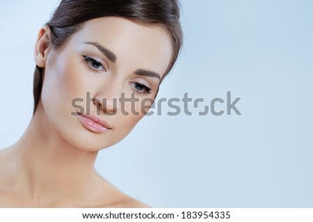 Beautiful tender girl with perfect health skin and natural makeup - stock photo