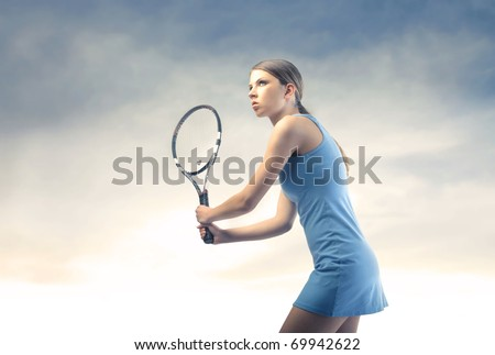 Beautiful tennis player - stock photo