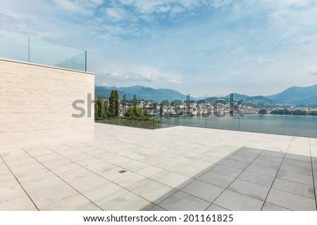 beautiful terrace of a modern penthouse, lake view  - stock photo