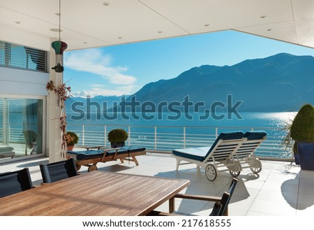 beautiful terrace of a penthouse overlooking the lake, outside - stock photo