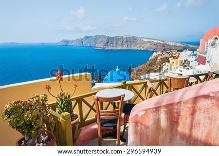 Beautiful terrace with sea view. Oia town, Santorini island, Greece. - stock photo