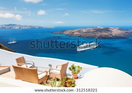 Beautiful terrace with sea view. Santorini island, Greece. - stock photo