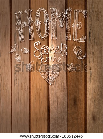 Beautiful text Home sweet home illustration with flowers, hand lettering with wooden background - stock photo