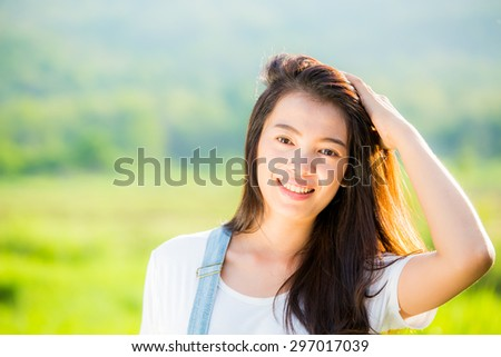 beautiful Thai  girl in park - stock photo