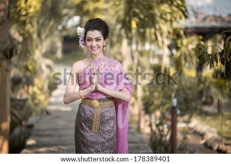 Beautiful Thai girl in Thai traditional costume - stock photo