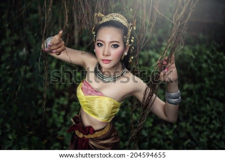 Beautiful Thai lady in Thai traditional drama dress - stock photo