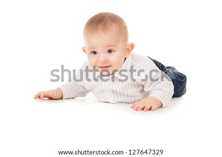 beautiful the child in clothes crawling on the floor isolated on white background
