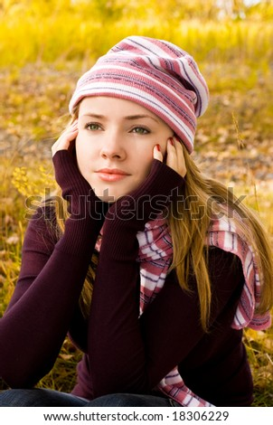 beautiful thoughtful girl in the park - stock photo