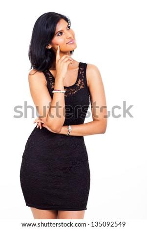 beautiful thoughtful indian woman looking up - stock photo