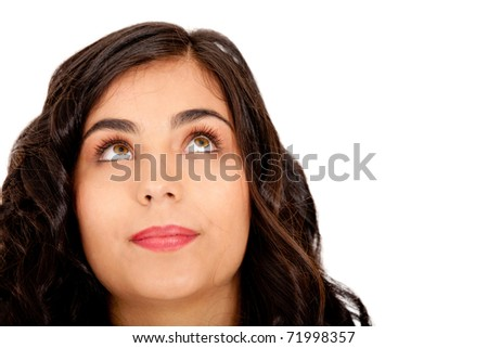 Beautiful thoughtful woman looking up - isolated over white - stock photo
