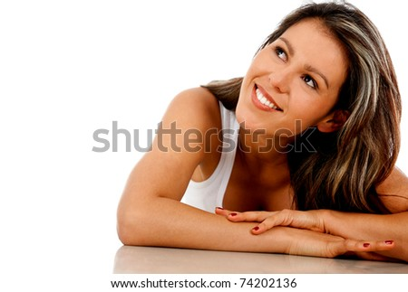Beautiful thoughtful woman lying on the floor � isolated
