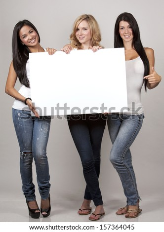 beautiful three women having fun on light background - stock photo