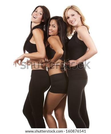 beautiful three women measuring their waist on white background - stock photo