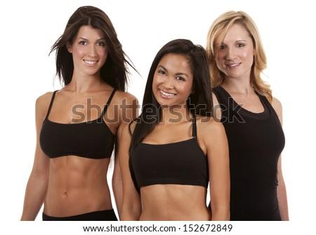 beautiful three women wearing fitness on white background - stock photo