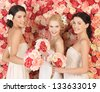 beautiful three women with background full of roses - stock photo