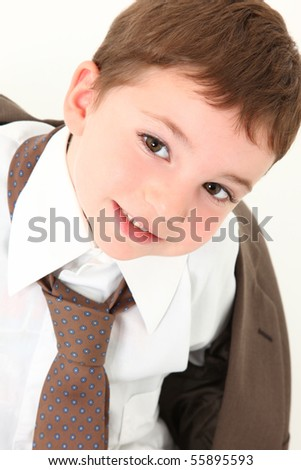 Beautiful three year old caucasian boy in over sized business suit. - stock photo