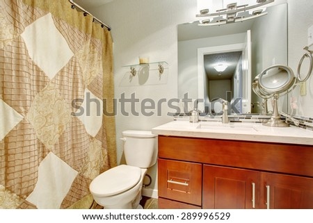Beautiful tile bathroom with full bath and shower.