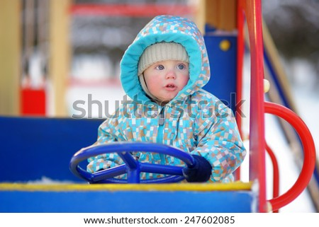 Beautiful toddler boy having fun on playground - stock photo