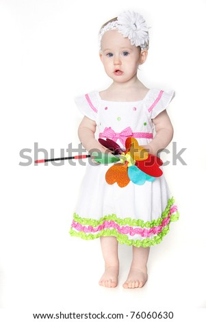 beautiful toddler girl with flower over white