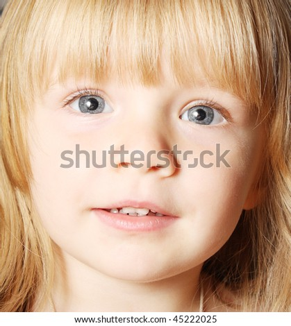 Beautiful toddler looking at the camera - stock photo