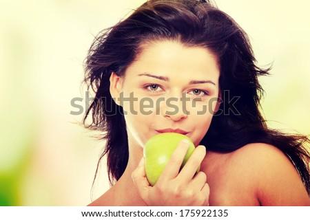 Beautiful topless girl with green apple - stock photo