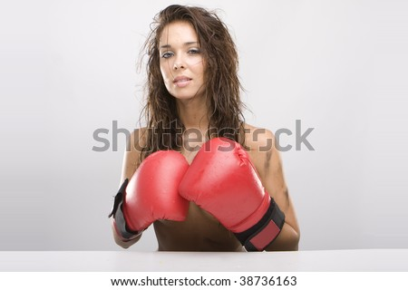 Beautiful topless glamour woman with red boxing gloves - stock photo