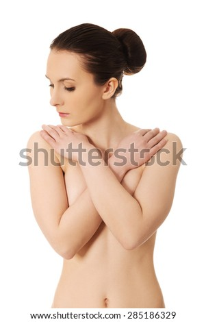 Beautiful topless woman covers her breast. - stock photo