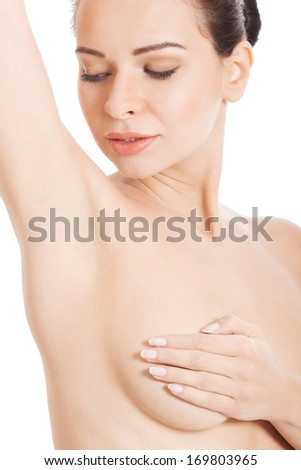 Beautiful topless woman with covered breasts. Isolated on white. - stock photo