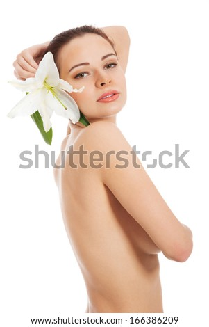 Beautiful topless woman with white lily. Isolated on white.