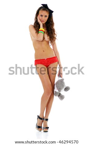 Beautiful topless young woman in red shorts - stock photo