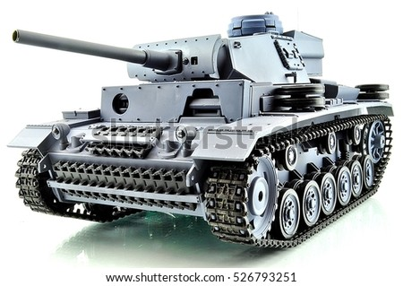 beautiful toy for children and adults, a copy of a military tank on the radio on a white background