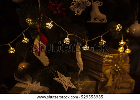 Beautiful toys and gifts on Christmas tree. Concept of Happy New Year