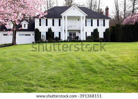 Beautiful traditional estate home on a large property. - stock photo