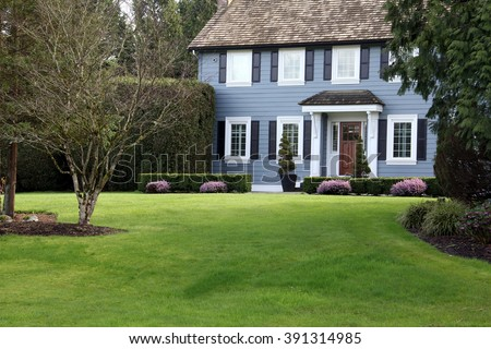 Beautiful traditional home on a large property.  - stock photo
