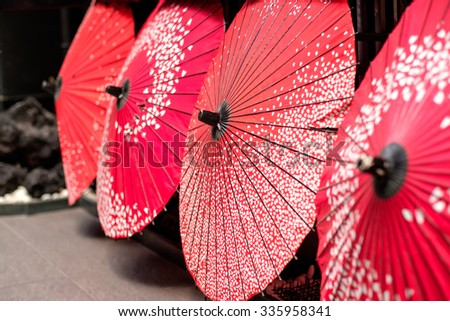 Beautiful traditional japanese bamboo umbrella in Kyoto - stock photo
