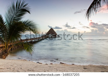 Beautiful tranquil beach sun rise in southern Belize
