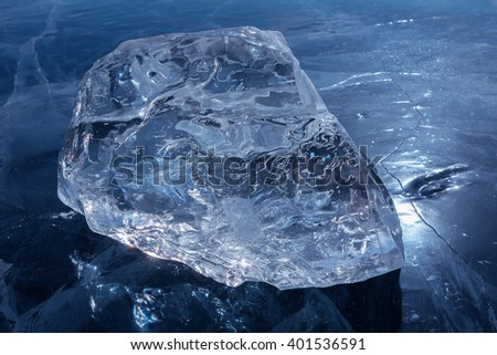 Beautiful transparent block of ice. - stock photo
