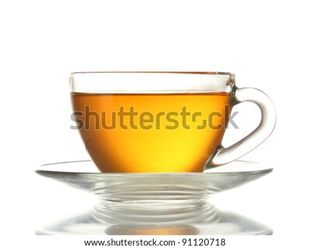 Beautiful transparent cup of tea isolated on white - stock photo