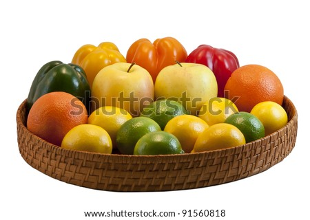 Beautiful tray with colorful fruits and vegetables - bell peppers, apples, oranges, lemons and limes isolated on white