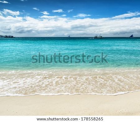 Beautiful tropical beach and blue sky. - stock photo