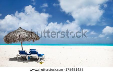 Beautiful tropical beach and Caribbean sea - stock photo