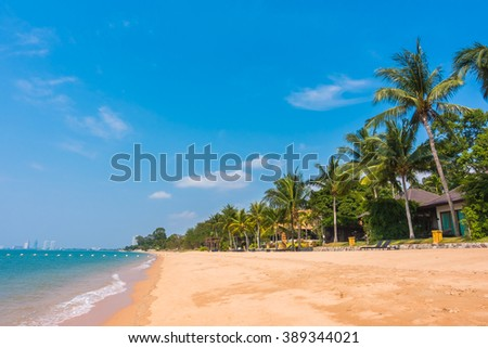 Beautiful tropical beach and sea with palm tree - Boost up color Processing