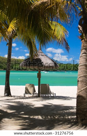 Beautiful tropical beach in luxury resort in Mauritius - stock photo