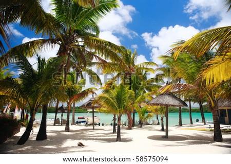 Beautiful tropical beach in luxury resort in Mauritius - stock photo