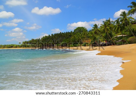 beautiful tropical beach landscape with clouds - stock photo