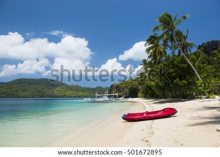 Beautiful tropical beach with a kayak