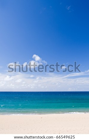 Beautiful tropical beach with blue sky and clouds - stock photo