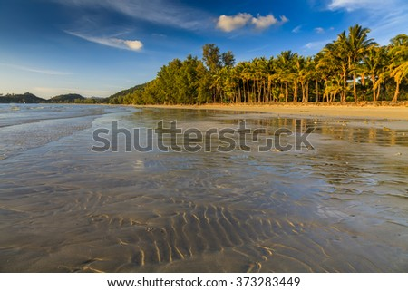 Beautiful tropical beach with coconut palms. Koh Chang. Thailand.