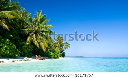 beautiful tropical beach with deck chairs (more beaches in my portfolio) - stock photo